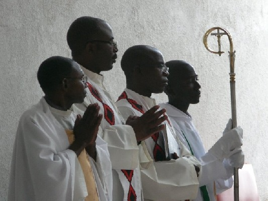 Fr. Muba, front, during the opening of St. Monica, his last public Mass